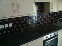 Kitchen tiling using black metro tiles